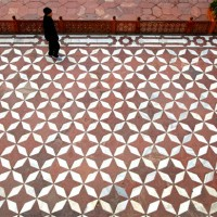 The lower platform with red sand stone and marble design at the Taj Mahal in Agra. The Taj Mahal has many interesting patterns used in the flooring in its exterior as well as in the interior of its buildings.