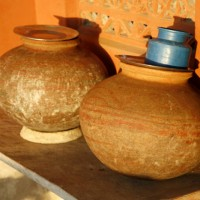 Clay Pitchers partly baked in burning cow dung cakes are commonly used in towns and villages all over India to store cool drinking water. The shapes of pitchers differ from one region to another.