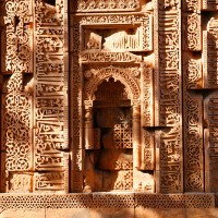 The Mehrab arch and its surrounding ornamentation has beautiful carvings from Hindu and Jain temples juxtaposed with Islamic calligraphy. It is part of Jami Masjid, built in 10th century CE.
