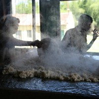 Cooling of Millet and Rice before forming into balls to feed the elephants.